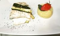 Filetto di Spigola su julienne di zucchine e tortino filante